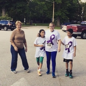 My sister, also a cancer survivor, and her kids crossing the finish line!
