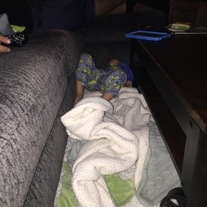 Our kid is a sleepwalker. This small space between the coffee table and coach was an interesting place.